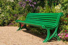 Green empty bench in garden Royalty Free Stock Image