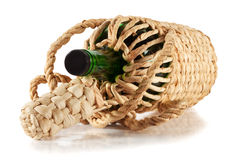 Green empty bottle in the braid Stock Image