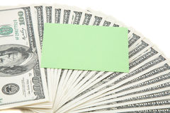 Green empty card on a spread of cash Stock Photography