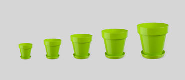 Green empty flowerpots - different sizes Stock Images