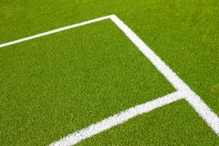 Green empty football soccer field with corner. Under daily light Stock Photos