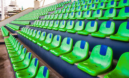 Green empty stadium seats. Of watch sports Royalty Free Stock Photo