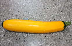 Green ended Golden zucchini. Green ended yellow zucchini, Cucurbita pepo, a unique golden unique with greens tips at both ends, cylindrical fruit attached by stock photography