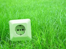 Green energy. Energy concept outlet in grass Stock Image
