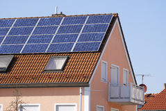 Green energy. Alternative energy at a residential house Stock Photos