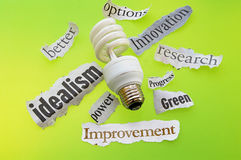 Green energy. Light bulb and green energy headlines Stock Photo
