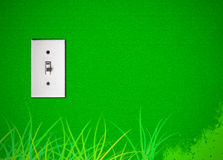 Green energy. A switch of electrical energy on a green wall Stock Photography