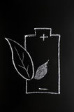 Green energy. Symbol drawn with chalk on a blackboard Stock Images