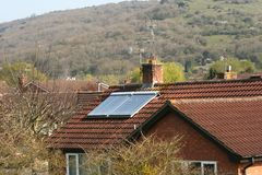 Green energy. Solar panel on the roof of an English house Royalty Free Stock Photo