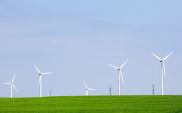 Green Energy. Modern wind energy plants on green fields Stock Images