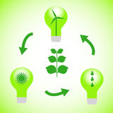 Green energy. Lightbulbs with green energy symbols Stock Images