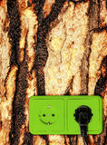 Green energy. Concept background - green outlets on the wood Stock Photography