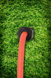 Green energy. Power cord against a moss background Royalty Free Stock Photos