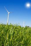 Green energy. Green field with two windmills Royalty Free Stock Photos