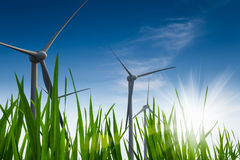 Green energy. Background ,  wind power with green grass against a blue sky Royalty Free Stock Images