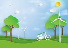 Green energy with bicycle and wind turbine on nature background Royalty Free Stock Image