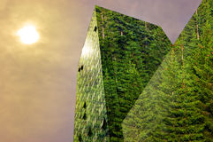 Green energy in the city: green modern building  Royalty Free Stock Photography
