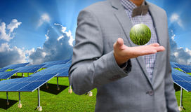 Green energy concept, Businessman carry world of wind turbine Royalty Free Stock Photos