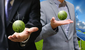 Green energy concept, Businessman carry world of wind turbine Stock Photos
