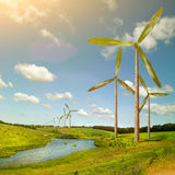Green energy concept - natural wind generator turbines on summer. Landscape Stock Photo