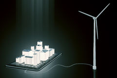 Green energy concept with smartphone with glowing 3D buildings a Stock Photo