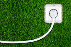 Green energy. Concept with socket Stock Images