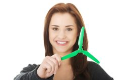 Green energy concept. Woman with windmill Royalty Free Stock Images