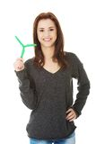 Green energy concept. Woman with windmill Stock Photo