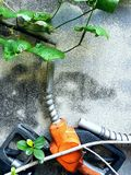 The green energy. The Fuel Nozzle and green leaf on the old wall Royalty Free Stock Images