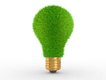 Green energy. Green grass on lightbulb surface Royalty Free Stock Photography