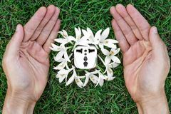 Green energy. Hands holding a socket with white flowers / green energy / save the world vector illustration