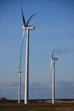 Green energy modern windmills Royalty Free Stock Image