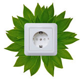 Green energy outlet. White outlet on green background like a green energy symbol Stock Image