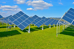 Green energy. Photovoltaic power plant on green meadow royalty free stock photography