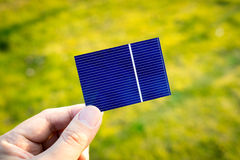 Green energy, Photovoltaic Solar Cell with hand Royalty Free Stock Photo