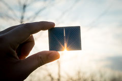 Green energy, Photovoltaic Solar Cell with hand. SONY A7 Royalty Free Stock Image