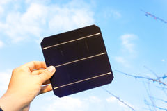 Green energy, Photovoltaic Solar Cell with hand. SONY A7 stock photography