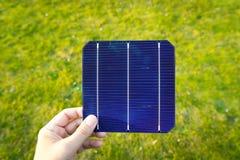Green energy, Photovoltaic Solar Cell with hand Stock Photos