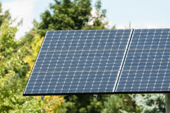Green Energy - Photovoltaic Solar Panel with Trees Stock Image