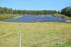 Green energy - solar panels in a feild. Green energy - photovoltaic solar panels in a rural field Royalty Free Stock Photos
