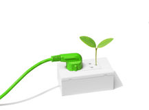 Green Energy. Green plug with a young green plant / Green energy concept Stock Photos