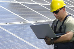 Green energy, power plant and engineer with laptop Royalty Free Stock Photos