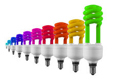 Multicolour light bulbs. Green energy saving light bulb with multicolour one's isolated on white royalty free stock photo