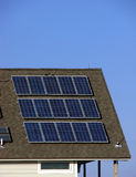 Green Energy Saving Solar Panels on Building Roof stock photo