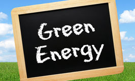 Green energy sign in field Royalty Free Stock Images