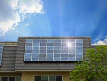 Green energy of solar cell panel on house roof. In blue sky and sunlight stock photo