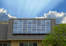 Green energy of solar cell panel on house roof. In blue sky and sunlight royalty free stock images