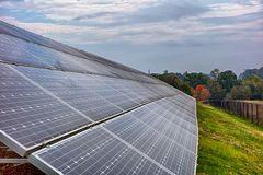 Green energy solar panels on a cloudy day Stock Image
