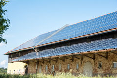 Green Energy. With solar panels on a old agricultural building Royalty Free Stock Photo