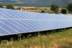 Green energy solar panels stock image